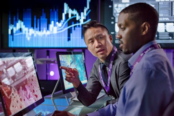 Image of Leidos employees working together